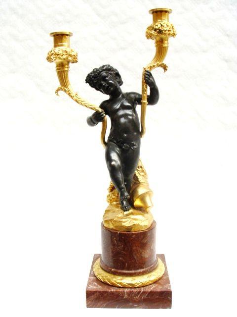 Bronzový svícen mimino