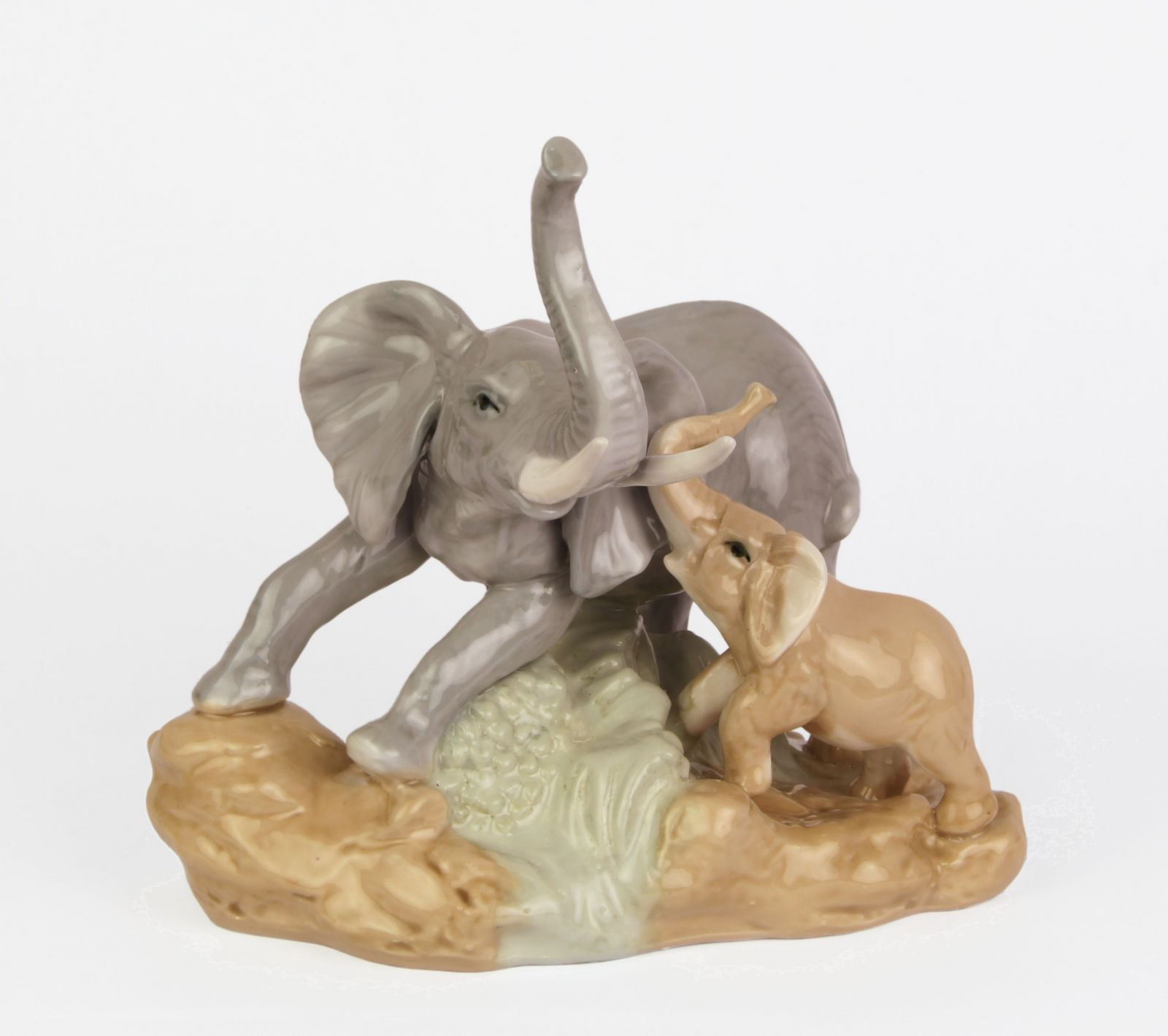 A PORCELAIN GROUP OF AN ELEPHANT AND CALF
