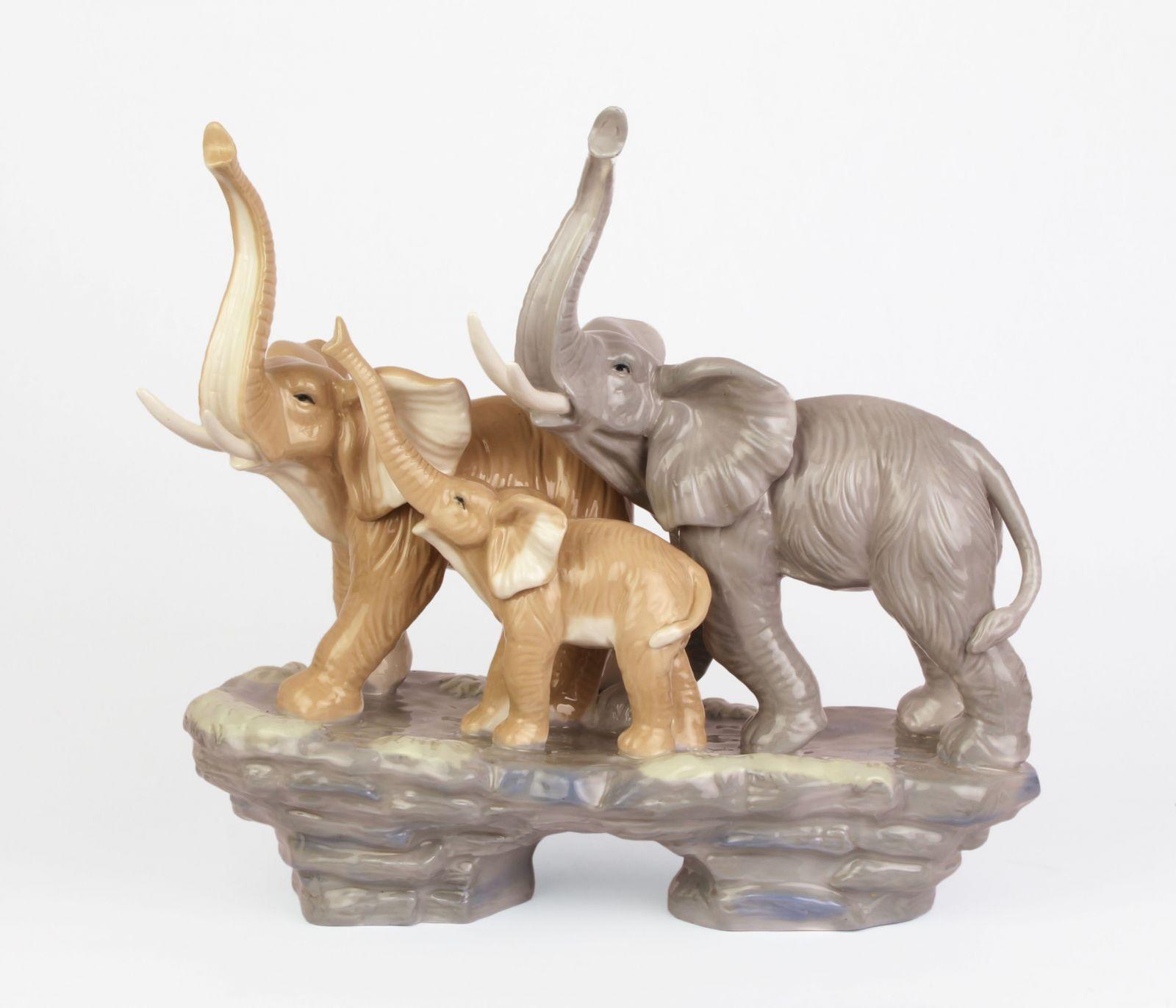 A PORCELAIN GROUP OF AN ELEPHANT FAMILY